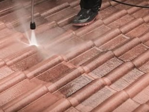 A Professional High Pressure Cleaning A Rooftop