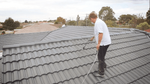 Professional Roof Painting Of A Dark Residential Rooftop