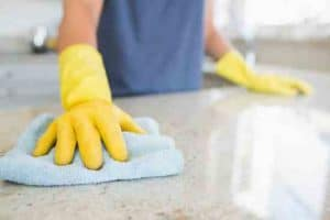 Cleaning and disinfecting a kitchen bench